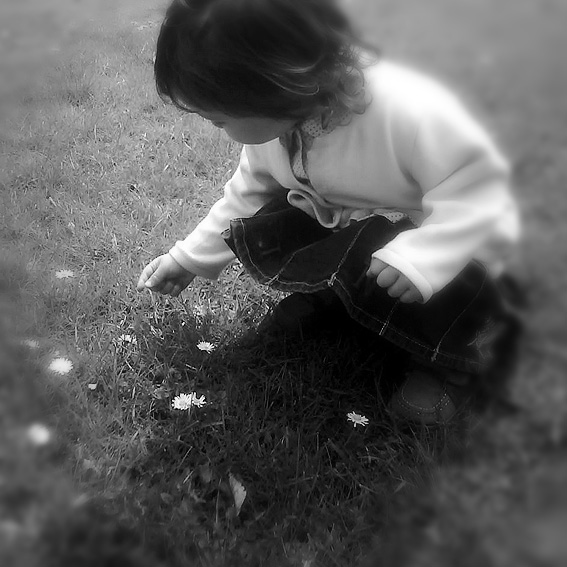 Toddler picking flowers_B&W